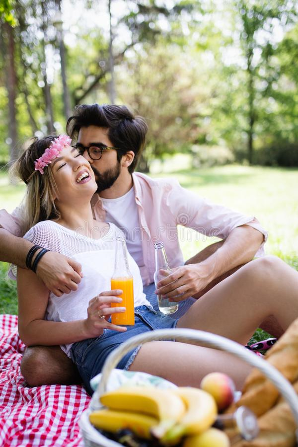 Happy couple on vacation. Lovers enjoy each other in the park, picnic. Happy couple on vacation. Lovers enjoy each other in the park stock photography