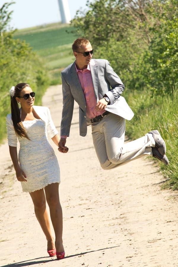 Happy couple walk stock images