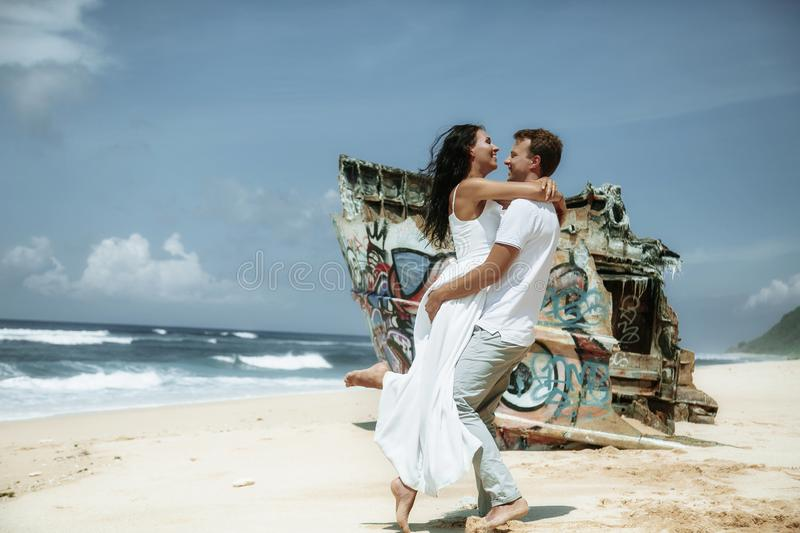 Happy couple walking at the beach, traveling at Bali. stock photography