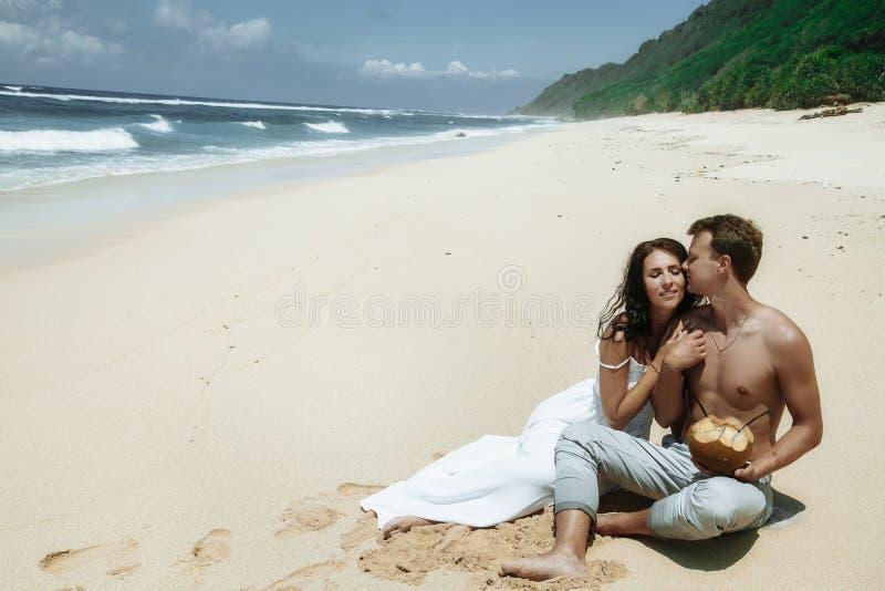 Happy couple walking at the beach, traveling at Bali. stock photo