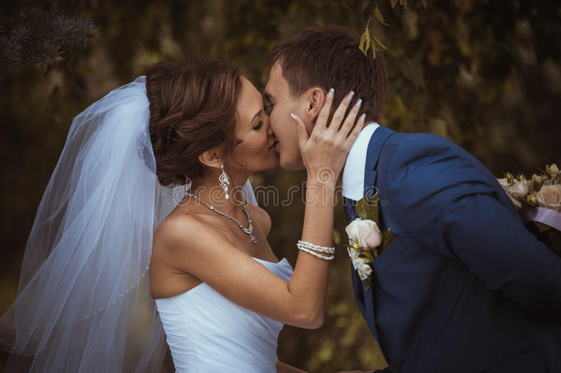 Happy couple on wedding day. Bride and Groom. stock photos