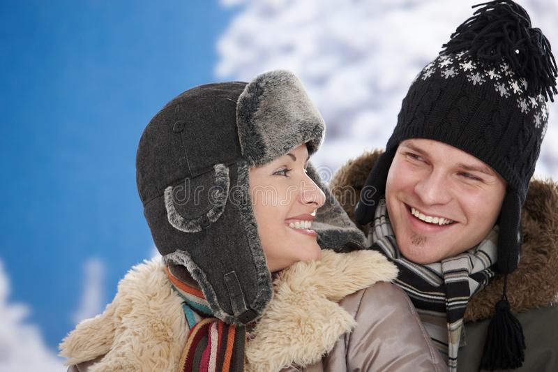 Happy couple at winter royalty free stock photography