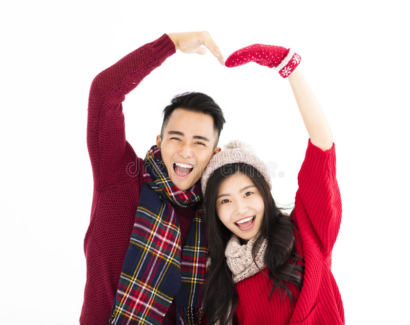 Happy couple in winter wear with lovely gesture. Happy asian couple in winter wear with lovely gesture royalty free stock images