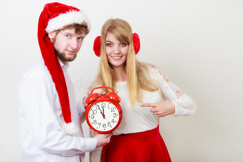 Happy couple woman and man with alarm clock. royalty free stock image