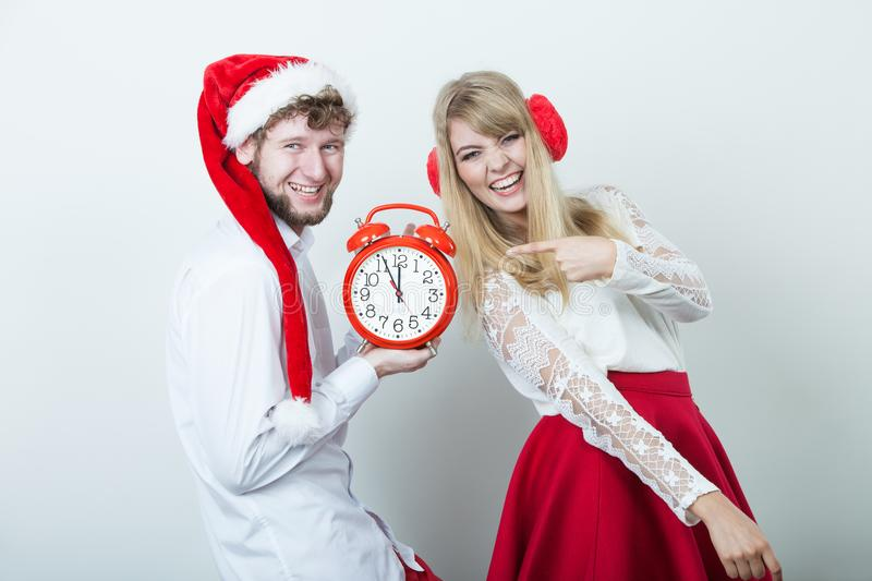 Happy couple woman and man with alarm clock. stock image