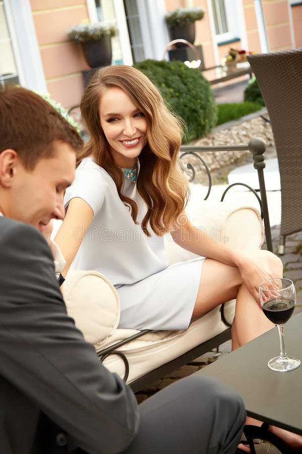 Happy couple woman man smile love hug relationship valentines. Beautiful couple on a date at restaurant lunch, dinner, flirt talking. Valentine's Day holiday of royalty free stock photo