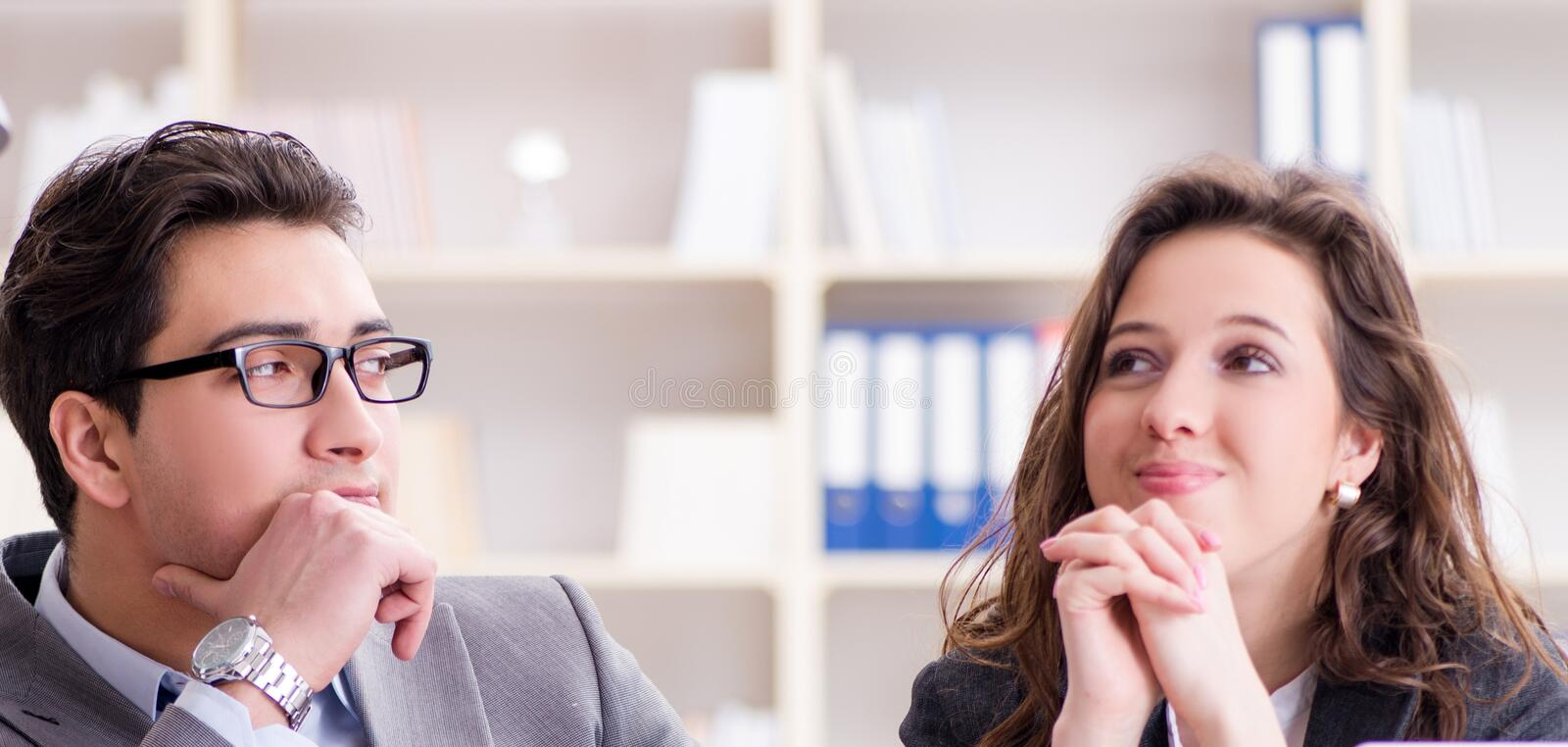 Happy couple working in the same office. The happy couple working in the same office royalty free stock images