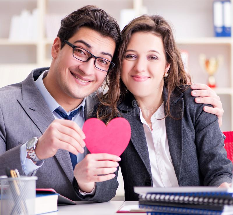 Happy couple working in the same office. The happy couple working in the same office stock image
