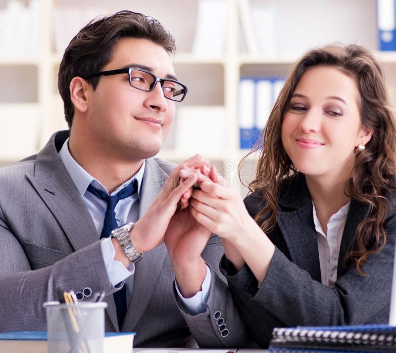 Happy couple working in the same office. The happy couple working in the same office royalty free stock image