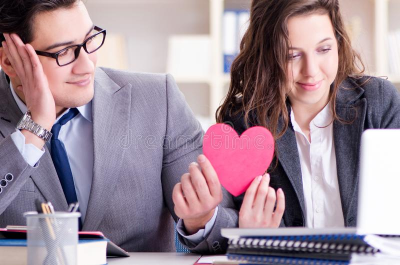 Happy couple working in the same office. The happy couple working in the same office stock photography