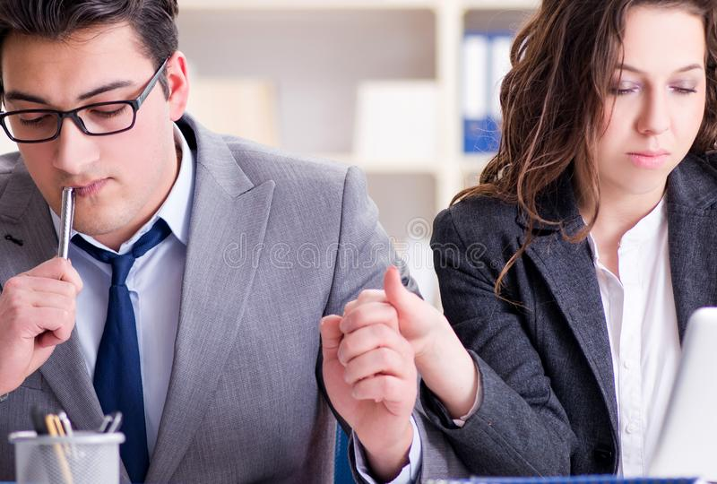 Happy couple working in the same office. The happy couple working in the same office royalty free stock photo