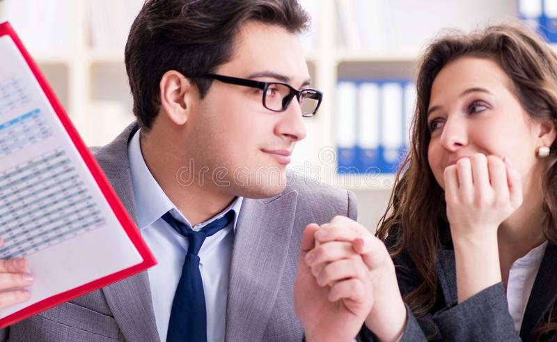 Happy couple working in the same office. The happy couple working in the same office royalty free stock photography