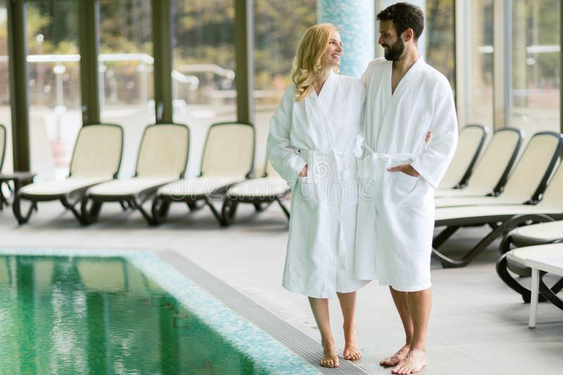 Happy couple relaxing at wellness spa center royalty free stock photography