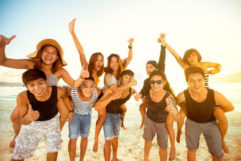 Happy couples on beach royalty free stock photos