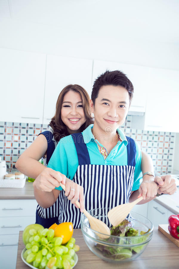 Happy couples in kitchen royalty free stock photo