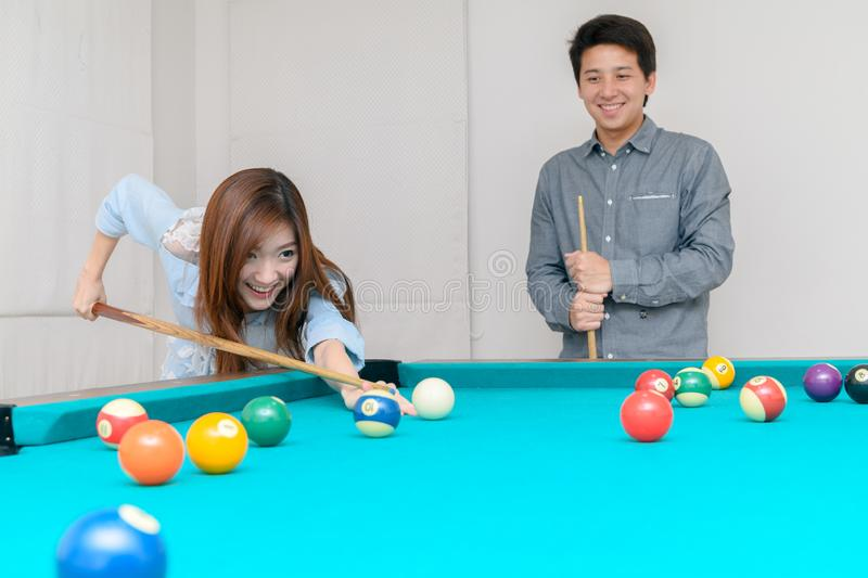 Happy couples are playing billiards in home, royalty free stock image