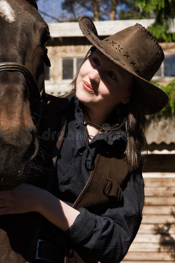Download Happy Cowgirl With Brown Horse Stock Photo - Image: 19961704
