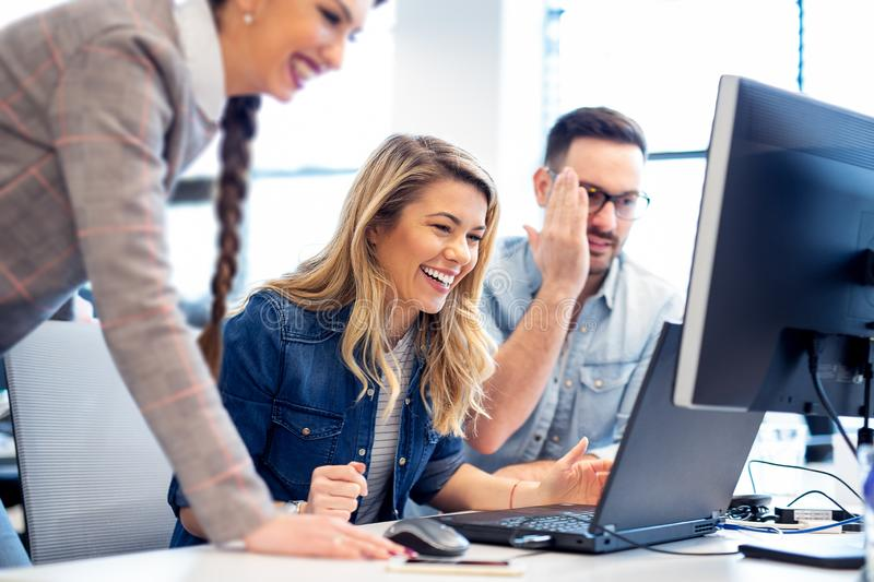 Happy coworkers analyzing final version of the project before a. Meeting royalty free stock photo
