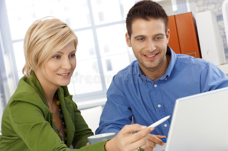 Download Happy Coworkers Working Together Stock Photo - Image: 23868830