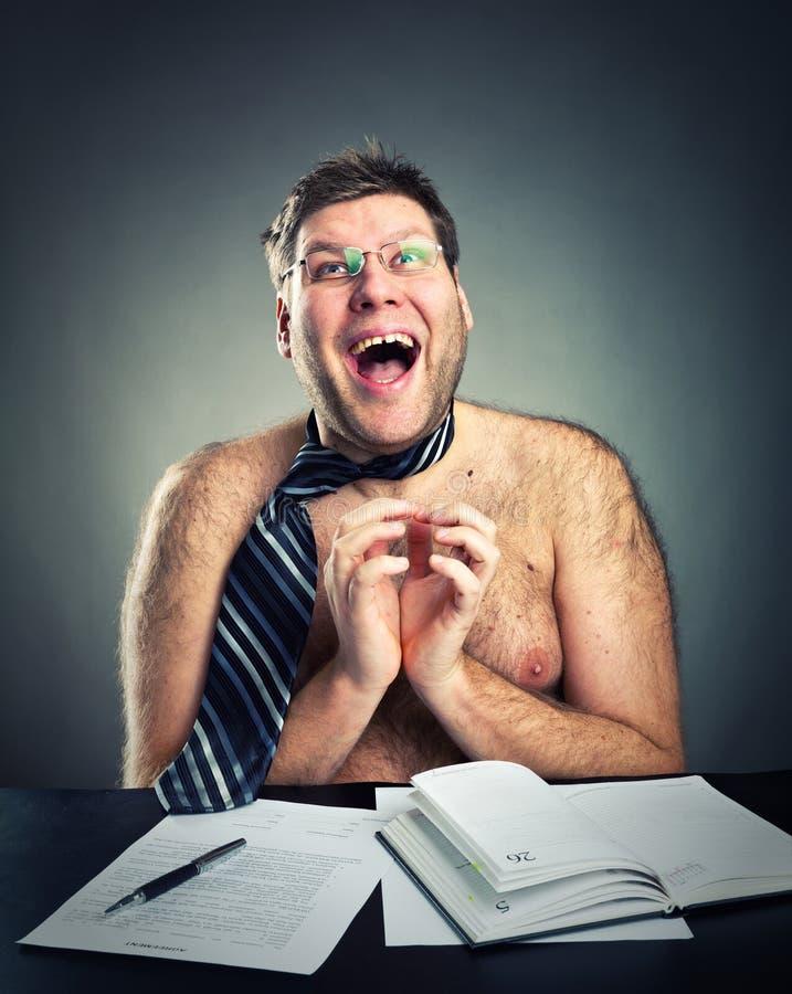 Happy crazy businessman. Happy crazy shirtless businessman studio image royalty free stock photo