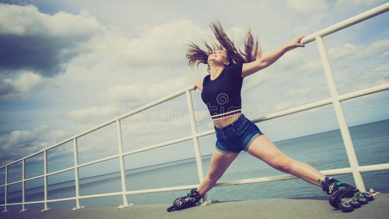 Happy crazy woman wearing roller skates royalty free stock image