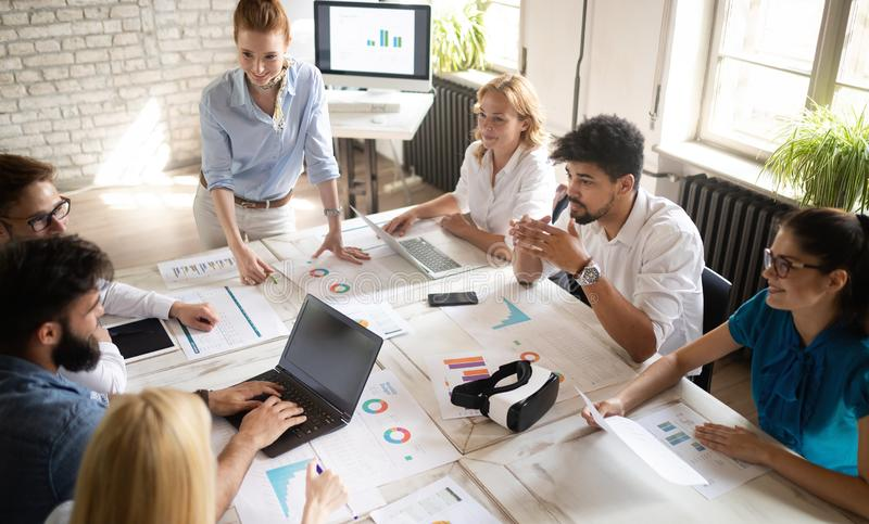 Happy creative team in office. Business, startup, design, people and teamwork concept royalty free stock images