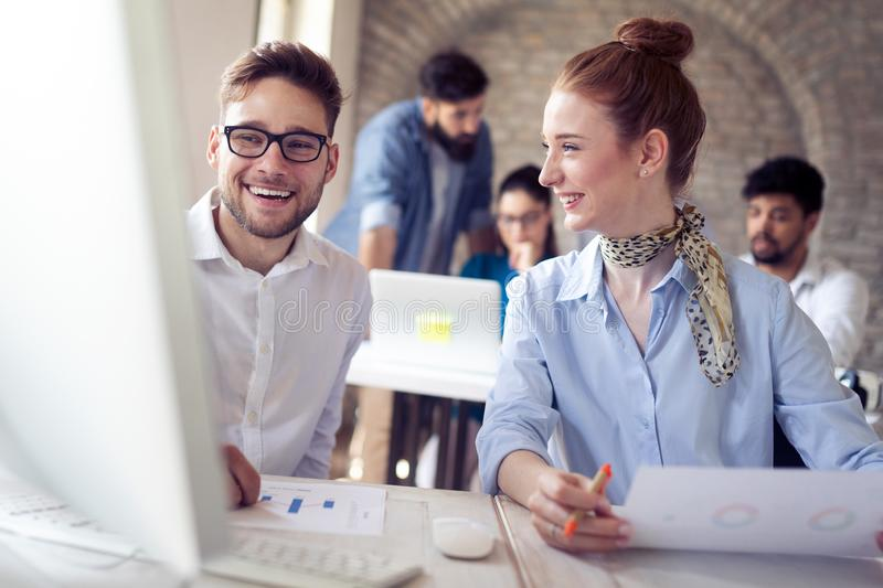Happy creative team in office. Business, startup, design, people and teamwork concept royalty free stock photo