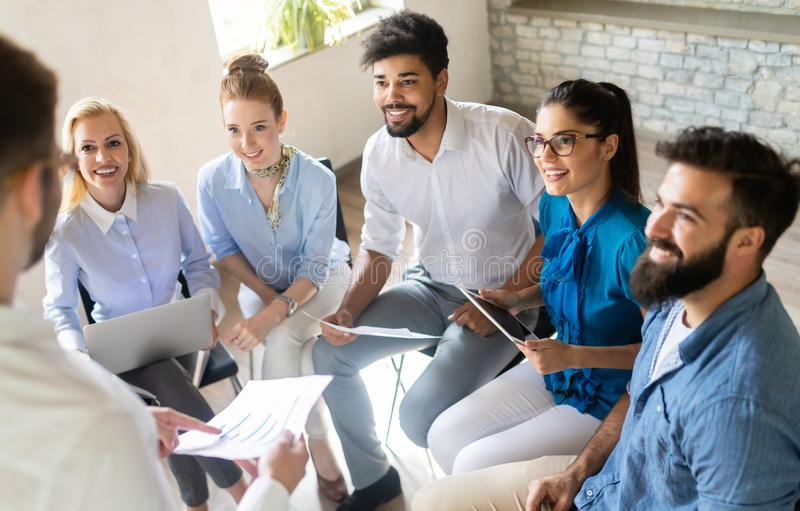 Happy creative team in office. Business, startup, design, people and teamwork concept stock image