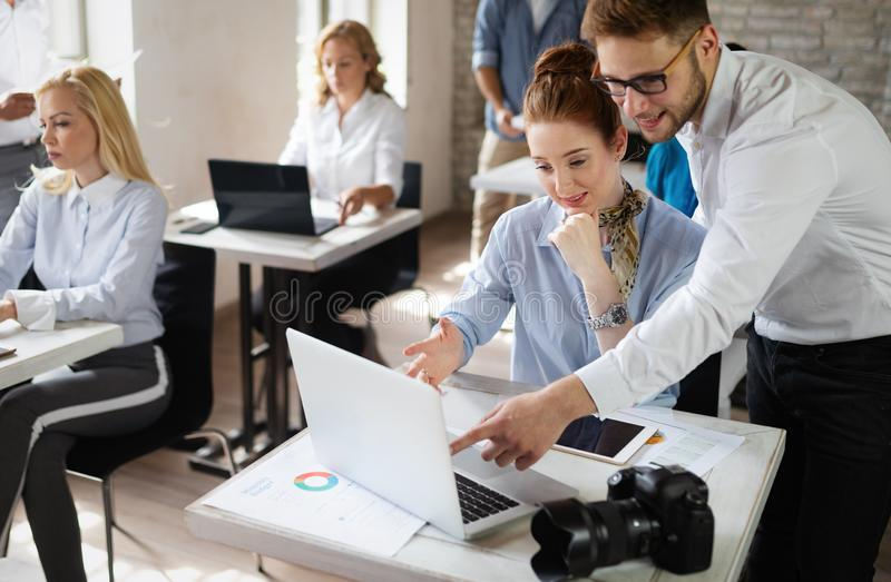 Happy creative team in office. Business, startup, design, people and teamwork concept royalty free stock photography