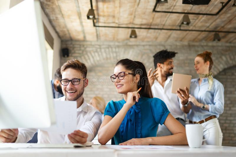Happy creative team in office. Business, startup, design, people and teamwork concept royalty free stock image