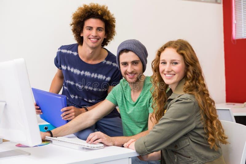 Happy creative team in office stock photo
