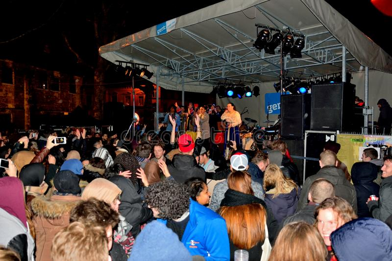 Happy crowd watching a Arabic band performing in Ghent royalty free stock photo