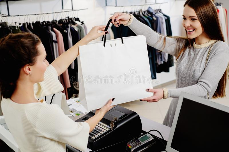 Happy customer with shopping bag royalty free stock photos