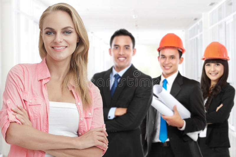 happy customer standing in front of her house contractor or buil stock photos