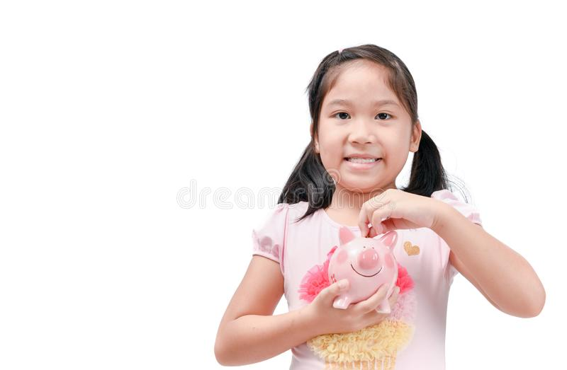 Happy cute asian girl holding pink piggy bank stock images