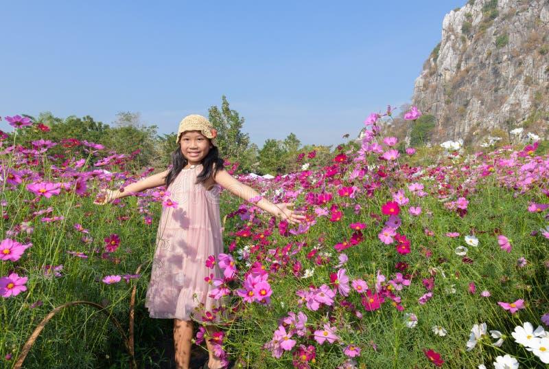 Happy cute asian girl smile in cosmos garden stock photos