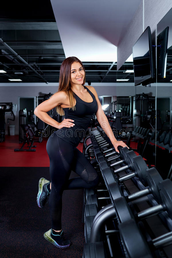 Happy cute athletic girl smile in gym. royalty free stock photo