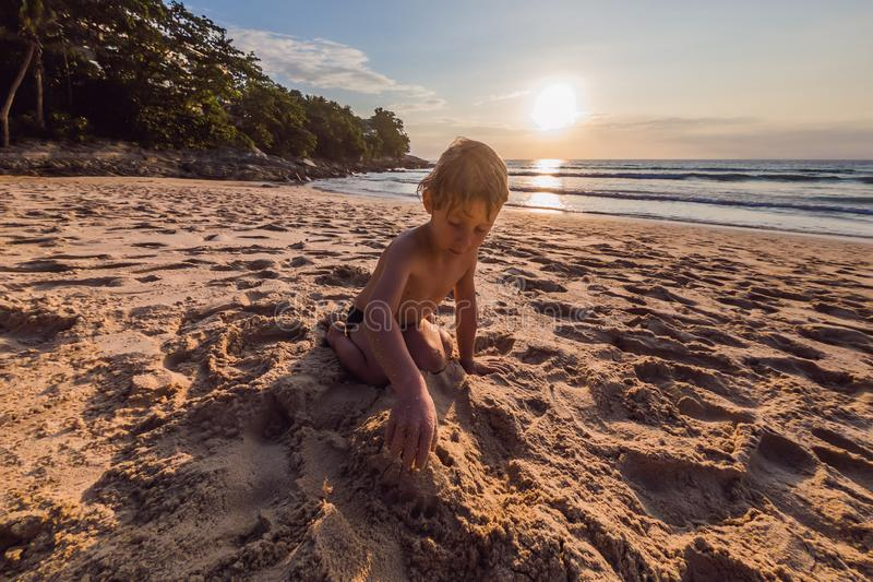Happy cute boy playing in the beach stock photography