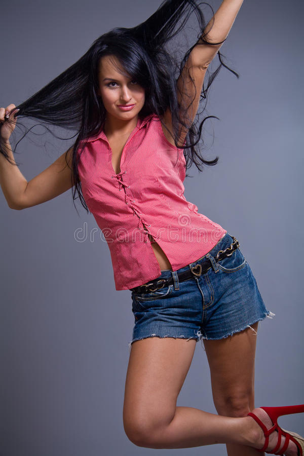 Download Happy Cute Brunette Girl Wearing Shorts Stock Image - Image: 20654279