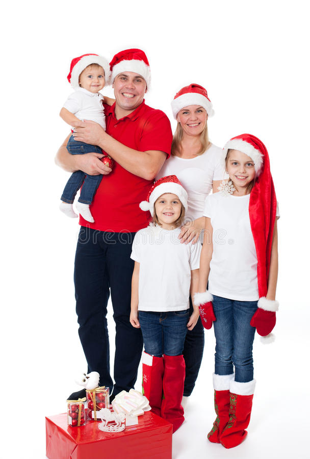 Happy cute family in santa's hats stock photo