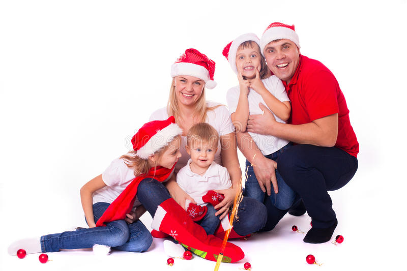 Happy cute family in santa's hats royalty free stock images