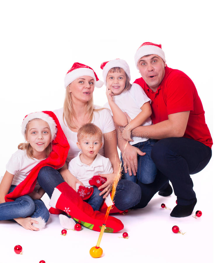 Happy cute family in santa's hats stock photography