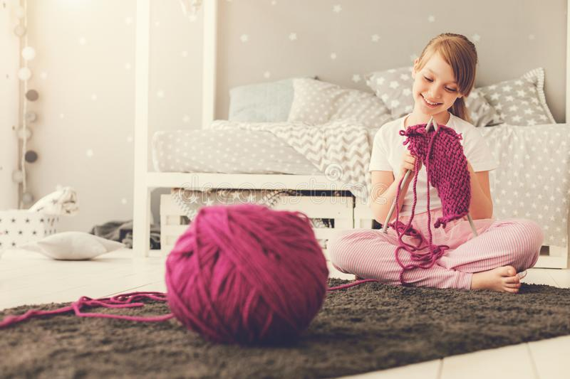 Happy cute girl knitting royalty free stock images