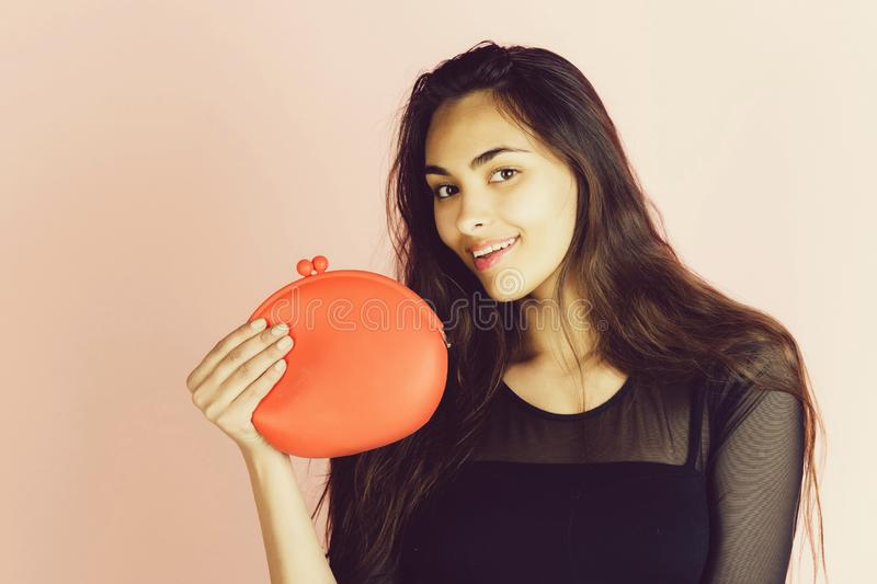 Happy cute girl smiling with stylish, red handbag royalty free stock image