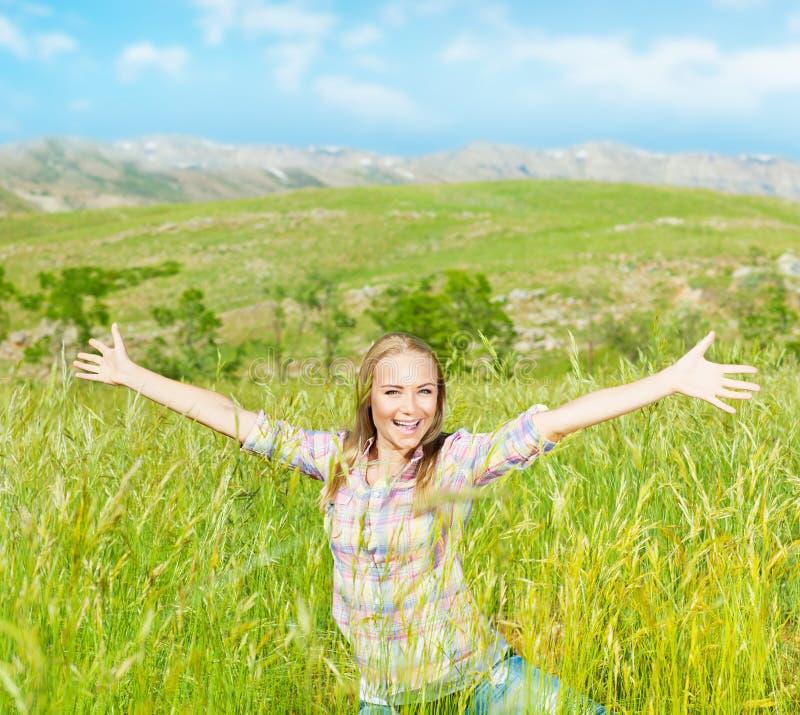 Happy cute girl on wheat field stock image