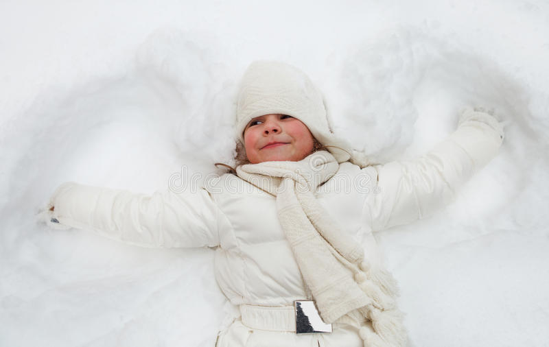 Happy cute little girl in winter park royalty free stock photo