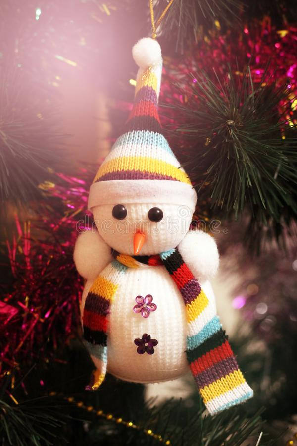 Happy cute smiling toy snowman in hat and scarf royalty free stock photos