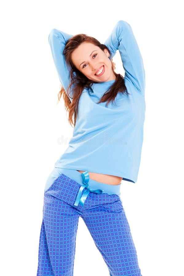 Happy cute woman in blue pyjamas stock images