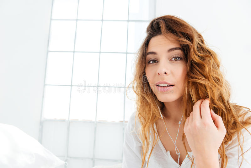 Happy cute woman with earphones stock photography