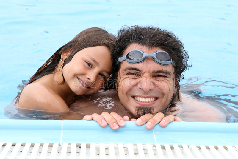 Happy dad father and child in pool stock photo